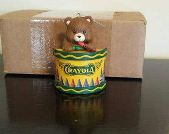 Crayola plastic ornament. Adorable bear holding crayons popping out of a crayola box!