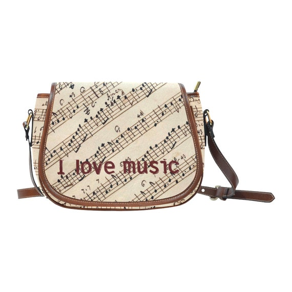 Exquisite ladies' handbag waterproof material with a print sheet music manuscript score for a woman girl musician music lover I love music