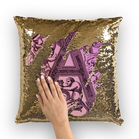 Monogram A with medieval ornament on a pillow with shining sequins in the form of mermaid scales is the best gift for a friend named A