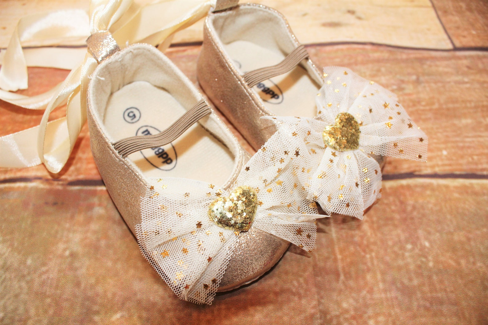 baby girls gold shoes, sparkly, glittery, ballet style, ribbon tie & hearts decoration, cake smash
