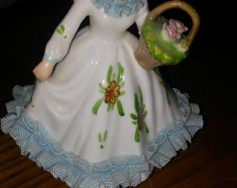Lefton Royal Dover girl in blue dress holding basket figurine