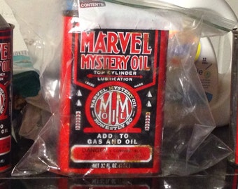Vintage marvel motor oil set of 3 advertising oil cans sold as a lot