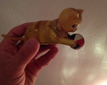 Early vintage Rare cat chasing ball toy