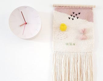 Woven Wall Hanging, with light spring colors and a detailed lively design