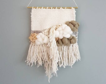 Woven Wall Hanging, with a lot of texture and fluffy clouds. Neutral colors like olive green, grey and ivory.Including raffia.Ready to ship!
