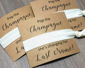 Pop the Champagne She's Changing Her Last Name Hair Tie Favors | Bachelorette Party Favors | Bachelorette Hair Ties | Bridesmaid Favors