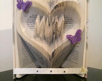 Beautiful mum in a heart book