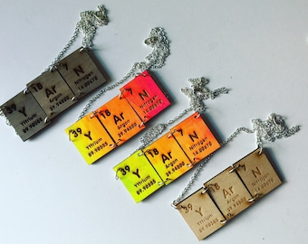 YArN periodic table element necklaces