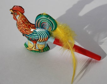 Vintage Reproduction Tin Rooster Whistle with yellow feather tail