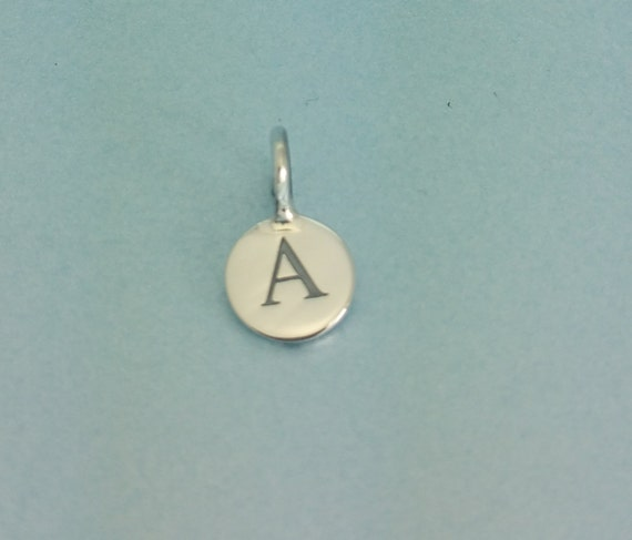 Sterling silver initial disc charm sterling silver initial charm sterling silver initial disc charm sterling silver initial charm silver letter charm 925 sterling alphabet charm from tinyweetreasures on etsy studio aloadofball Images