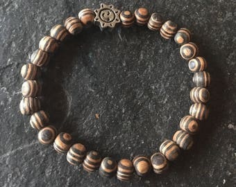 Wooden beaded stretchy bracelet with pewter sun