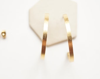 forged gold-plated earrings