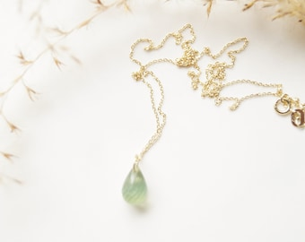 golden delicate necklace with prenith drops