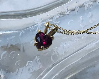 Small tourmaline heart in gold