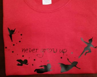 Child/Youth Never Grow Up T-Shirt (Many Sizes , Styles, and Colors)