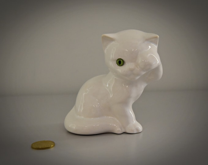 Cute vintage puffs Figurine-white porcelain-green glass eyelets
