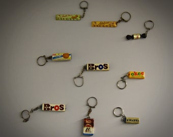 Vintage key rings / advertising / theme chocolate / 1968 / set of 9 pieces
