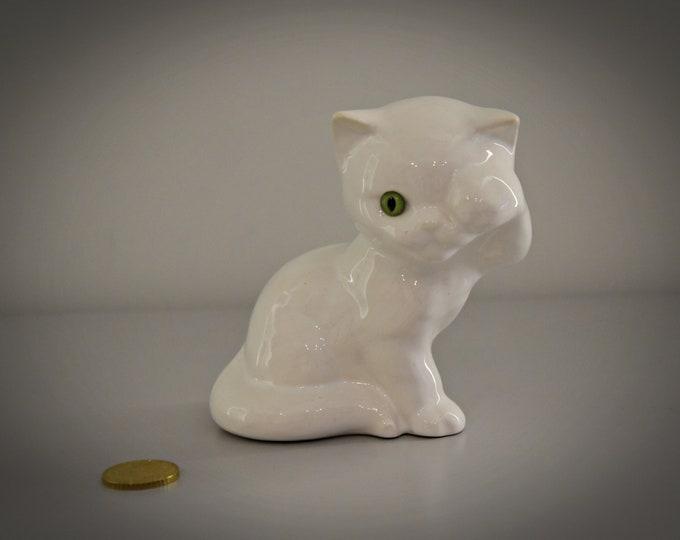 Cute vintage puffs Figurine-white porcelain-green glass eyelets