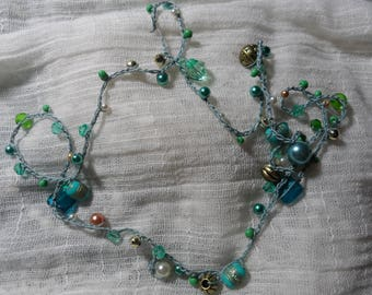 Long teal beaded crocheted necklace