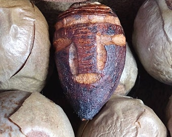 African face Hand carved avocado seed  handmade yep hand carved unique and original