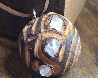 Hand carved avocado seed with rose quartz sensational handmade yep hand carved unique and original