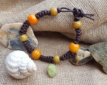 Brown leather braided bracelet with wooden beads.
