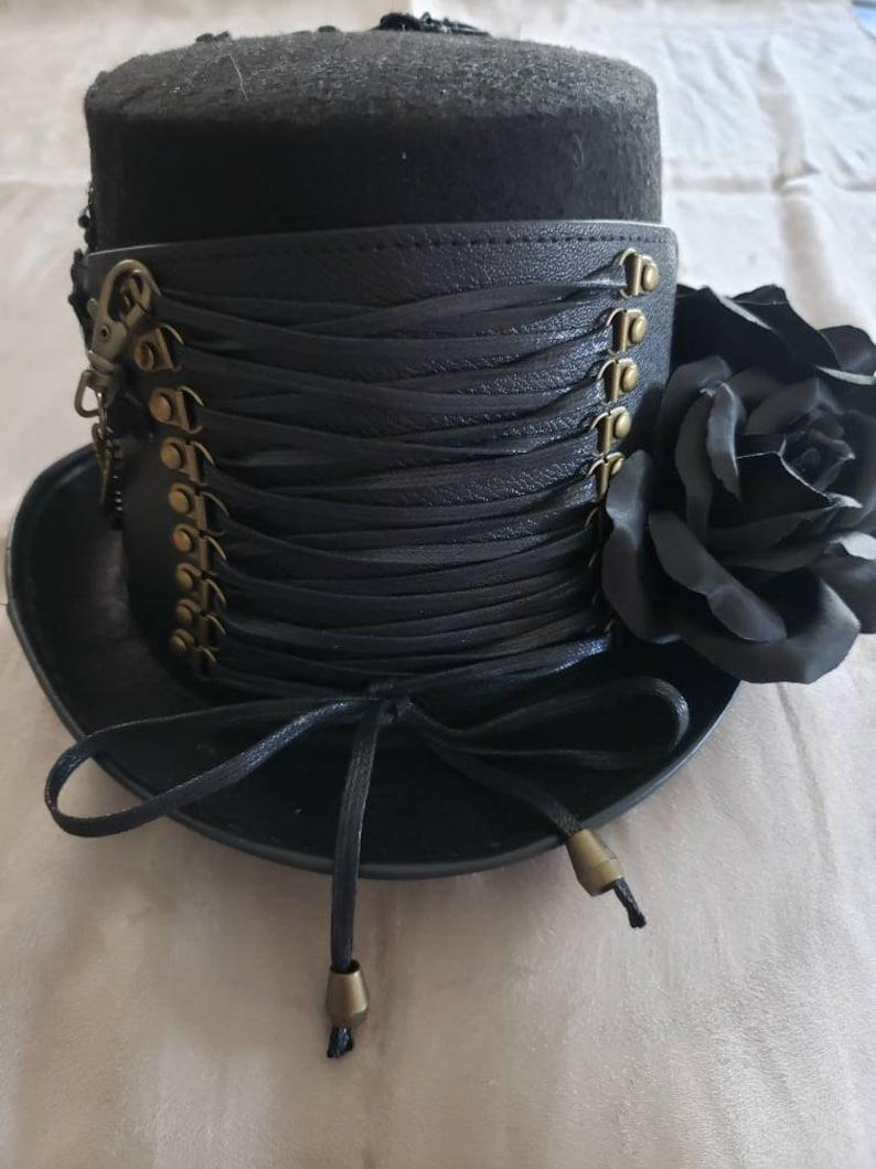 Steampunk Accessories | Goggles, Gears, Glasses, Guns, Mask     Steampunk style black corset hat $89.99 AT vintagedancer.com