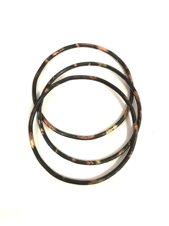 Set of Three Steel, Shakudo and Gold Bangles