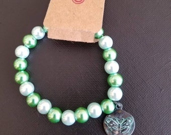 Glass pearl bracelet with butterfly charm