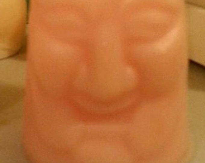 Penis shaped soap with happy face