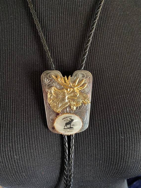 Prescott Moose Lodge Leather Bolo Tie with Gold Moose on a Silver Background with Mother of Pearl Accent