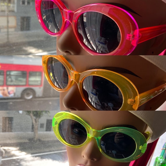 Fun Neon Plastic 80s-Inspired Sunglasses in Pink, Green, and Orange