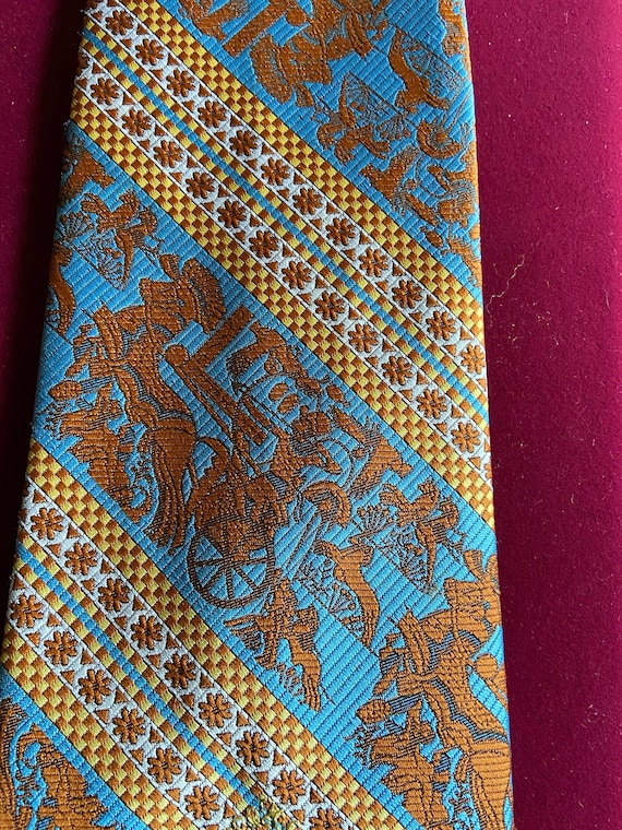 Awesome King Tut in a hunting scene  a  Vintage 1970s Orange and Blue Super Wide Tie from Oleg Cassini with