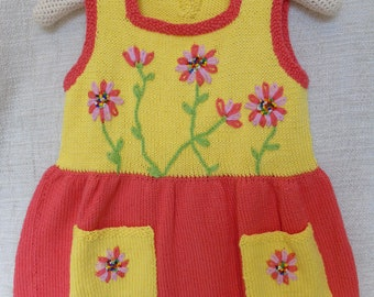 Summer dress with hand-knitted children 2 or 3 years old flowered