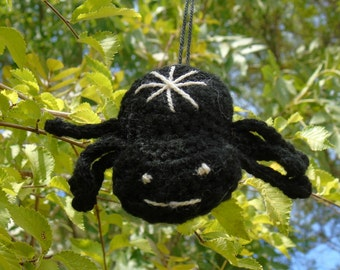 Black crochet spider in the form of amigurumi or brooch or Ludi key door one that weaves fate