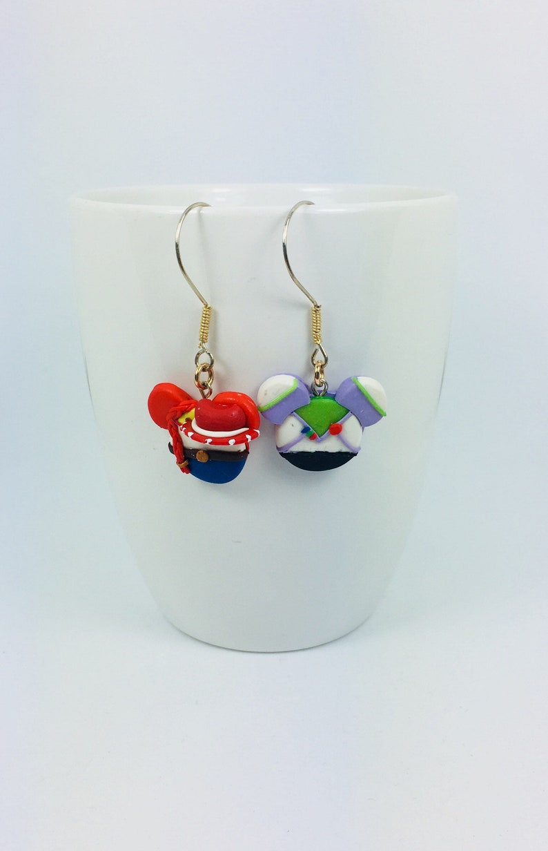 a0238c99ce33d Toy story Disney Inspired Dangle Earrings Buzz lightyear and Jessie Mickey  Mouse Head Polymer Clay Jewelry