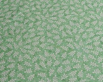 Cream Christmas Trees on Green Cotton Fabric