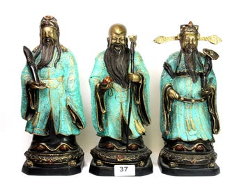 A set of three Chinese  cold painted and gilt figures of FU,LU and SHOU 29cm