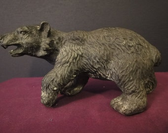 hollow cast bronze bear   length = 17cm