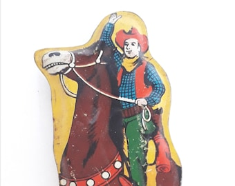 1950's Tinplate whistle with lithograph of a cowboy on  his horse. Made in Japan.