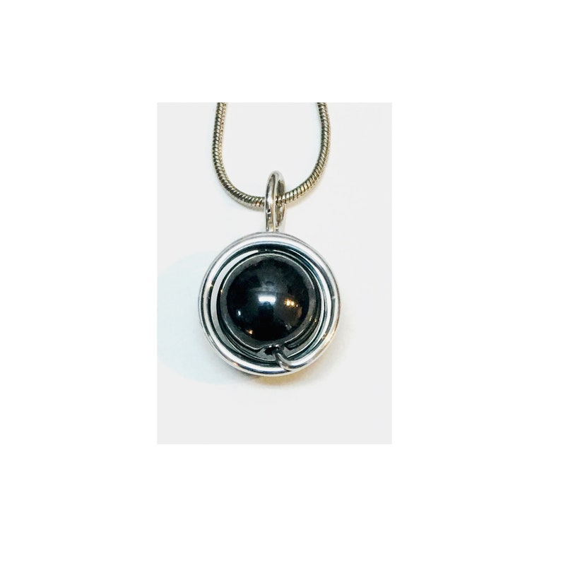 Aluminum wire decorated with a hematite bead pendant mounted image 0