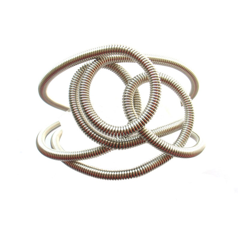 Hand-turned anodized aluminum spring wire 3 rows bracelet image 0