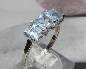 Silver ring with 3 topaz blue azure size 56