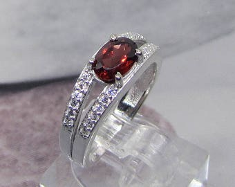 Women in fine silver rings and faceted Garnet size 56