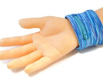 76ae8449d851 Blue zipper pocket wristband, gym ring holder sweatband