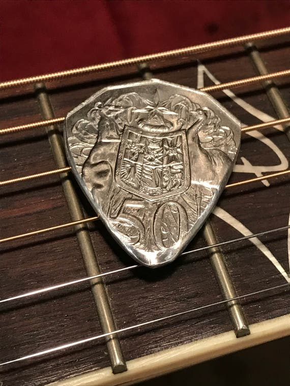 HAND CUT GUITAR PICK FROM A USA DIME TEN CENT COIN HAND CUT AND POLISHED