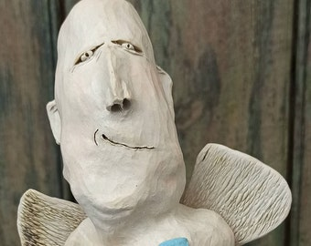 Men's head, angel, art object, sculpture of fine stoneware, white ceramic, handformed, carved, painted, frost hardy
