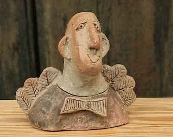 Cheerful angel in clay, ceramic, hand-formed, painted, double burned, frost hardy