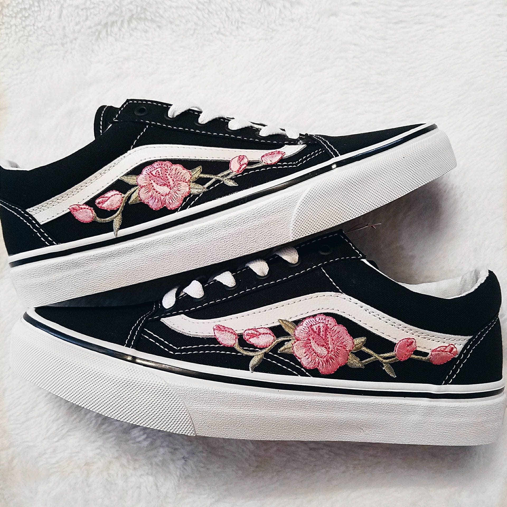 all black vans with pink roses