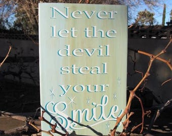 """Custom sign..""""Never let the devil steal your Smile"""" Two tone lettering overlay, Blue white and natural stain background 7.5 x 11"""" Great Gift"""